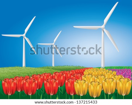 Wind turbines on colorful tulips field background.
