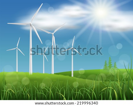 Windmills on the meadow on a background of sky and grass