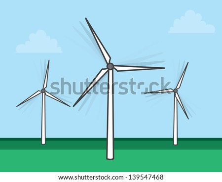 Windmills spinning in a grassy field