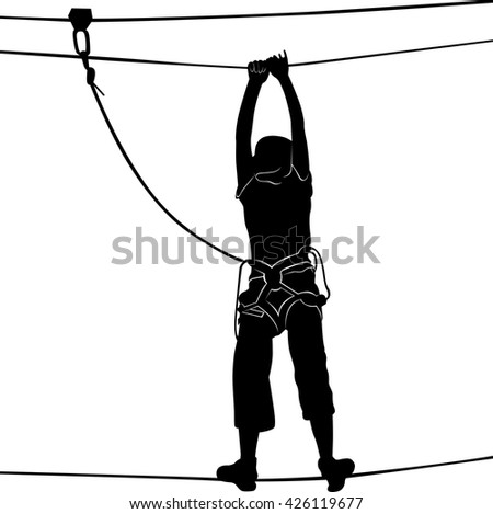 Woman on cables in an adventure park on a difficult course. Silhouette Adventure.