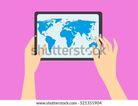 woman's hand holding a tablet with world map on the screen