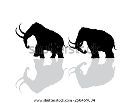 Wooly mammoth silhouettes over white background - stock vector