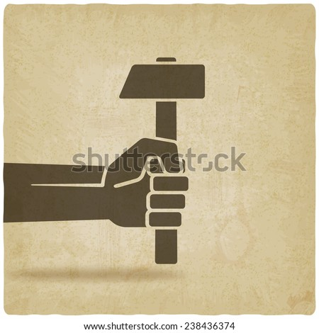 working symbol hand with hammer old background - vector illustration. eps 10 - stock vector
