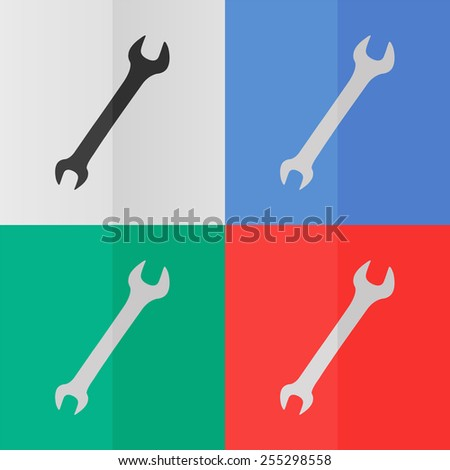 Wrench vector icon. Effect of folded paper. Colored (red, blue, green) illustrations. Flat design