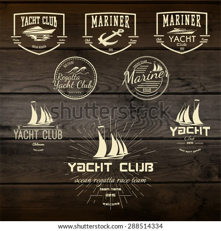 Yacht club badges logos and labels for any use. On wooden background texture - stock vector