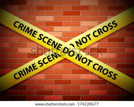 Yellow crime scene tape on a brick wall.