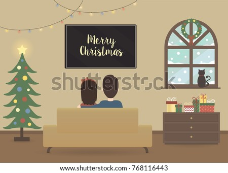 young couple watching tv in a christmas decorated interior of a house holidays decoration in - Christmas Tv Decoration