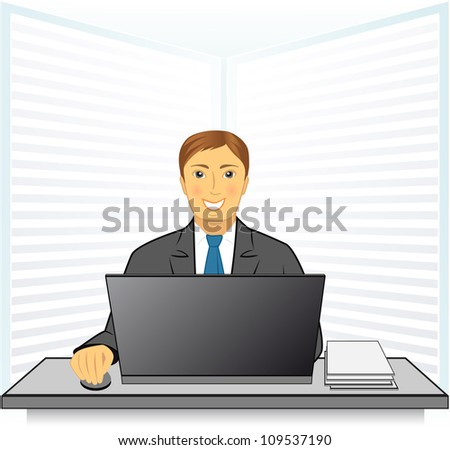 young happy man in business office with laptop