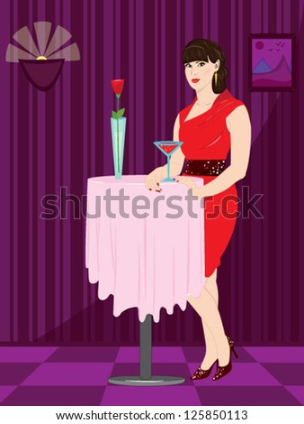 Young woman in red dress standing near the table