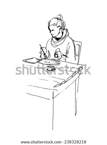 young woman using tablet computer and having lunch